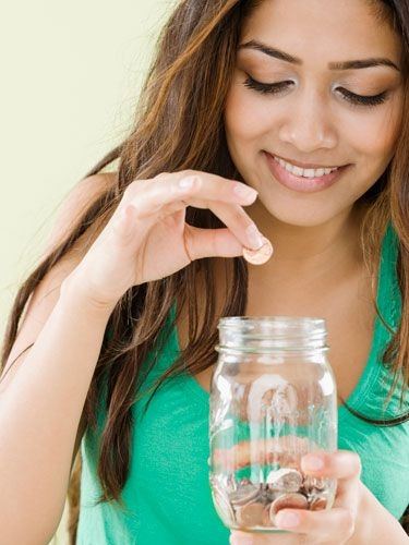 girl-saving-money-jar