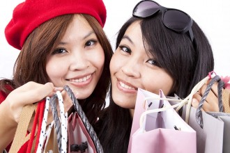 two asian shopping girl isolated on white background