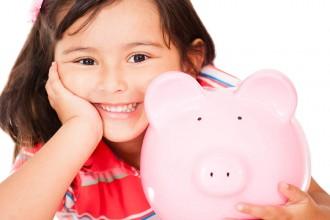 Little girl saving money
