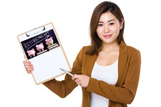 Asian businesswoman pen point to clipboard with white paper