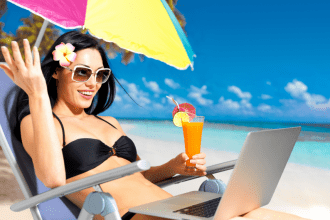 happy_woman_on_beach_with_laptop