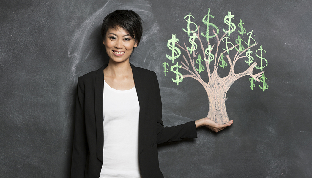 Asian woman and chalk money tree drawing on blackboard wealth mastery sg
