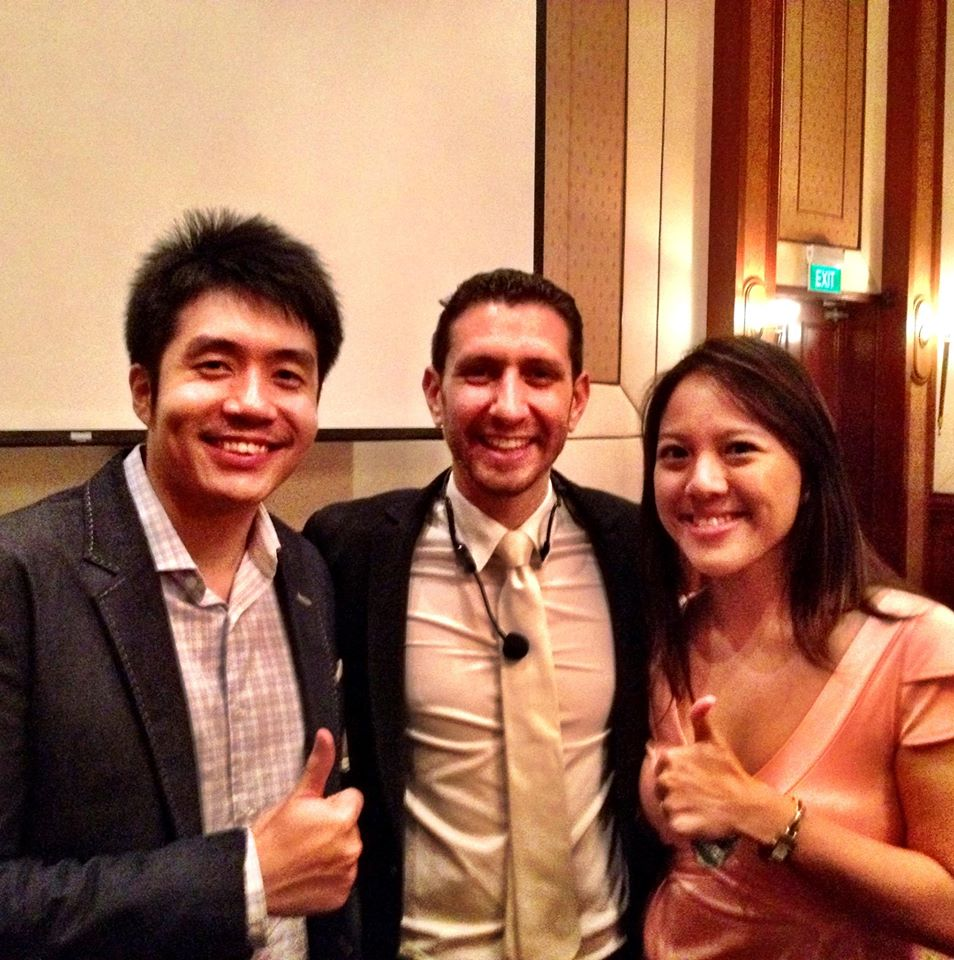 WealthMastery.sg's Calvin Woon and Patricia Lin with business coach Kane Minkus